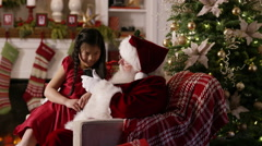Santa Claus takes cell phone selfie photo with girl Stock Footage