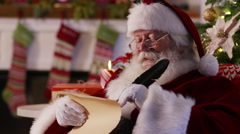 Santa Claus writes on naughty and nice list Stock Footage