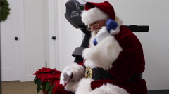 Santa Claus lifting weights in gym Stock Footage