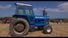 Vintage Ford Tractor at summer agricultural show Stock Footage