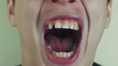 Young man pronounce words in front of camera. Open mouth. White teeth Stock Footage
