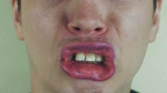 Young man make funny faces in front camera. Open mouth. Play the ape. Teeth Stock Footage
