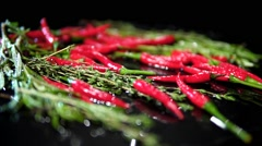 Red chilli under spraying water rotating Stock Footage