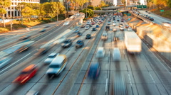 Time-lapse of rush hour freeway traffic in downtown LA Stock Footage