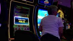 Motion of woman printing winning voucher on slot machine Stock Footage