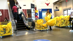Worker giving shopping bag for customer inside Ikea store Stock Footage