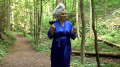 Woman at the forest is seeking a socket for hair dryer Stock Footage