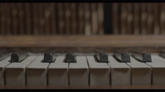 Piano Keys and exposed internal mechanism of strings and hammers 4K Stock Footage