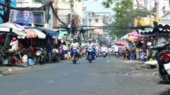 Street scene of daily life in Ho Chi Minh City Stock Footage