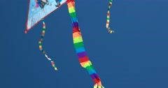 A small kite with colorful tail against the sky Stock Footage