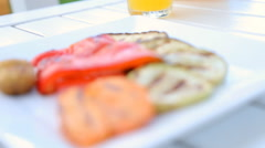 Grilled vegetables on the white plate on the wood table. Stock Footage