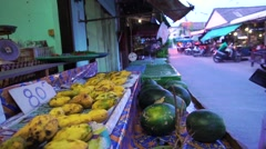 Man buying fruit at local market in Thailand Stock Footage