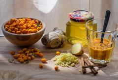 Sea-buckthorn berries in glass with other ingredients for healthy tea Stock Photos
