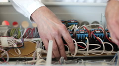 Manual assembly of electric fusebox Stock Footage