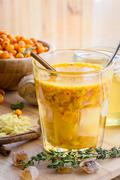 Seaberry honey ginger mix in glass Stock Photos
