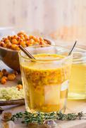 Sea buckthorn honey ginger mix in glass Stock Photos