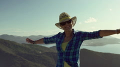 Woman standing on the hill and feeling free, steadycam shot Stock Footage