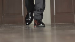 Unrecognizable businessman walking in the office. Slow motion Stock Footage