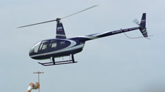 Private helicopter Robinson (R-44) is flying in slow motion. Stock Footage