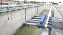 Wastewater treatment facility valves pipes defocus Stock Footage