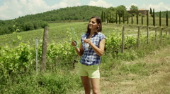 Happy woman pouring wine to the glass and degusting it, steadycam shot Stock Footage