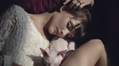 Sleeping girl with a sphinx cat Stock Footage