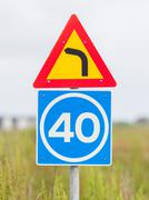 Curve with advisory speed limit Stock Photos