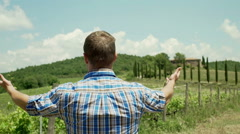 Man looking on his vineyard and having a failure, steadycam shot Stock Footage