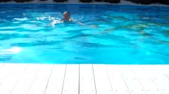 Woman floating in the pool water, give juice Stock Footage