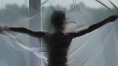 Young woman relaxing over window. Slow motion Stock Footage