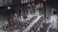 People inside of nave cathedral Stock Footage