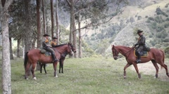 Mounted police patrolling forest Stock Footage