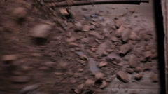 Iron ore falls on conveyor belt Stock Footage