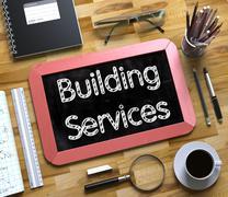 Building Services on Small Chalkboard. 3D Illustration Stock Illustration