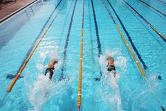 Swimmers Competing in Pool Stock Photos