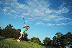 Female Golfer on Tee Stock Photos