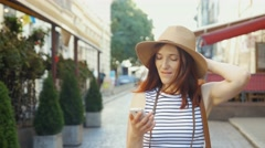Holidays and tourism - beautiful girl with phone, tourist book and vintage Stock Footage