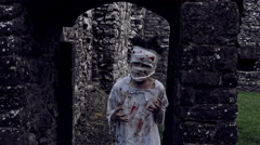 4k Horror Shot of an Abandoned Child acting like a Crazy Zombie Stock Footage