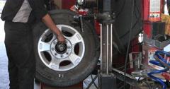 Wheel balance automobile repair shop DCI 4K Stock Footage