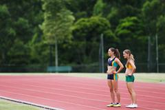 Two Female Runners On Race Track Stock Photos