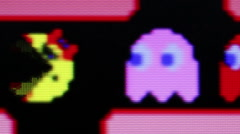 ECU Ms. Pac Man avoids, then eats, monsters during Ms. Pac Man Game Play Stock Footage