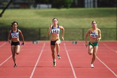 Female Runners On Racetrack Stock Photos