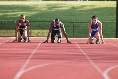 Runner On Race Track Preparing To Start Kuvituskuvat