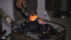Forging furnace, a horseshoe in the fire on the coals Stock Footage