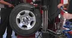 Wheel balance automobile repair shop fast motion DCI 4K Stock Footage