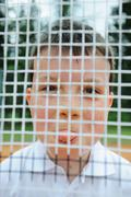 Boy See Through Tennis Racket And Showing Tongue Stock Photos