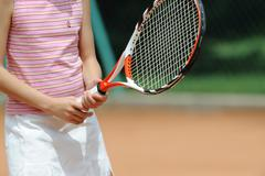 Mid-Section Of A Young Girl Holding Racket Stock Photos