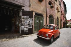 A Red Fiat 500 Car Parked In Street Stock Photos