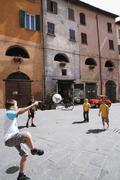 Boys Playing Street Soccer Stock Photos