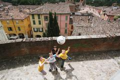 Boys Playing Soccer In Street Stock Photos